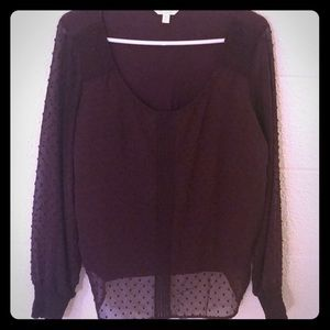 Long sleeve maroon sheer overlay top.